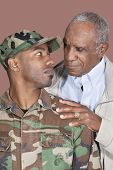 pic of united states marine corps  - Father and US Marine Corps soldier looking at each other over brown background - JPG