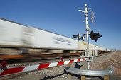pic of railroad-sign  - Train passing level crossing motion blur - JPG