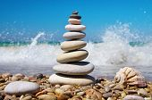 image of pyramid shape  - Stone pyramid on a seashore - JPG