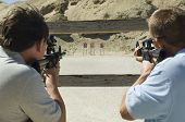 picture of rifle  - Men aiming rifles at firing range - JPG