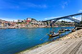 picture of dom  - Oporto or Porto city skyline Douro river traditional boats and Dom Luis or Luiz iron bridge - JPG
