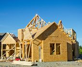 foto of 2x4  - Wood frame single family hlouse under construction - JPG