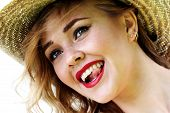 stock photo of cun  - A happy cunning girl with an open mouth showing her tongue.