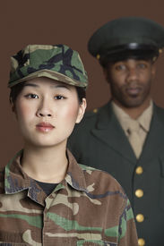 stock photo of united states marine corps  - Portrait of young female US Marine Corps soldier with officer in the background - JPG
