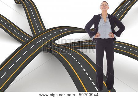 Happy businesswoman against bumpy road background