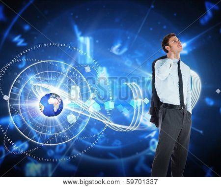 Serious businessman holding his jacket against blue background with letters, elements of this image furnished by NASA