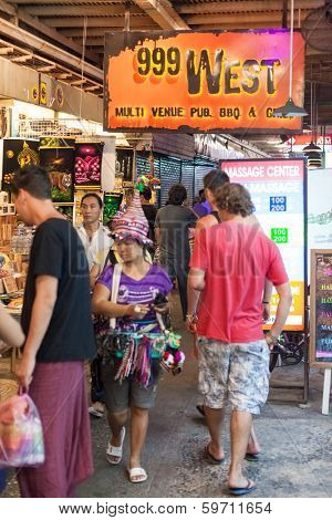 BANGKOK, THAILAND - JANUARY 9, 2012: Tourists visits Khao San Road Market. It has reached a landmark status as a must-visit place for tourists.