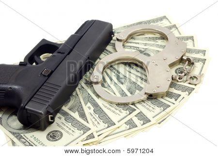 Black gun, bracelets and cash