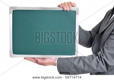 man wearing a suit holding a blank chalkboard