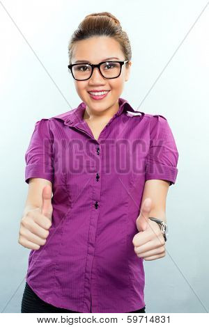 Asian Business woman having success showing it by giving a thumbs up