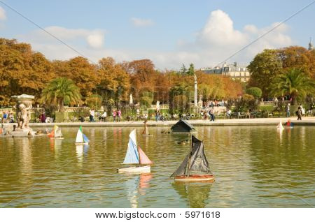 Toy Boats In The Luxembourg Garden Of Paris, France. Pirate Boat Is On The First Plan