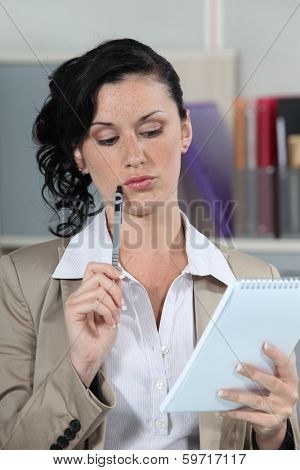 businesswoman reading and thinking