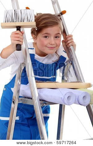 Young girl pretending to be a painter