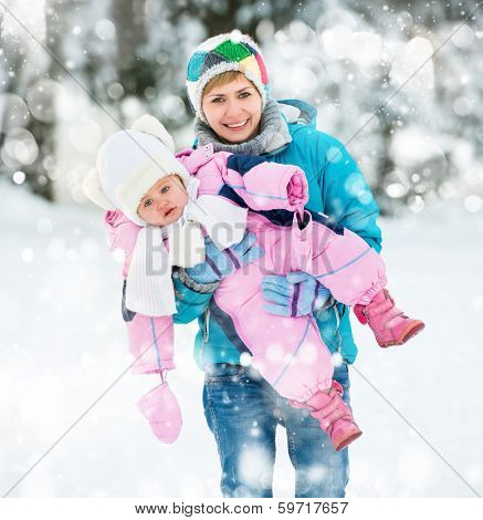 Happy and beautiful mother with a small child on a winter walk
