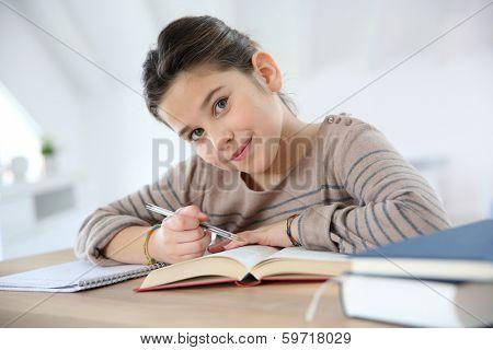 Portrait of 8-year-old girl doing homework