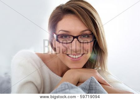 Portrait of middle-aged woman with eyeglasses