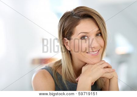 Portrait of attractive and smiling businesswoman