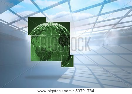 Green earth on abstract screen against room with holographic cloud