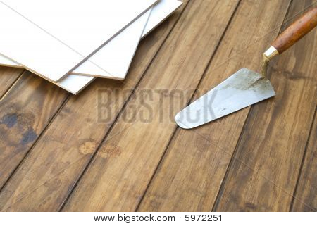 Home improvement floor tiles n wooden table with tools
