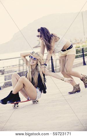 teens having fun with skateboard