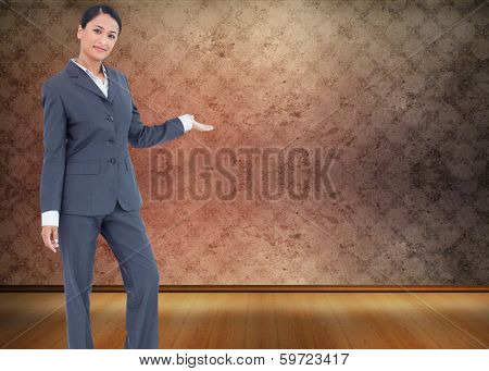 Standing businesswoman presenting against grimy room
