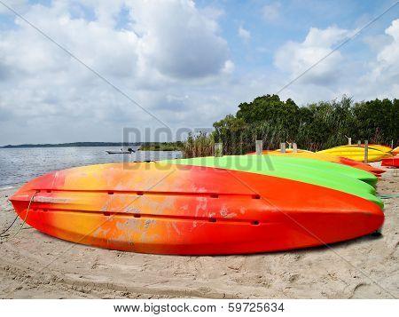 Colorful Kayaks On Beach