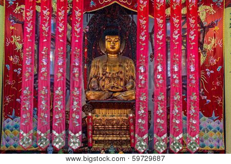 SHANGHAI - APRIL 7, 2013: Buddha statue in the The Jade Buddha Temple