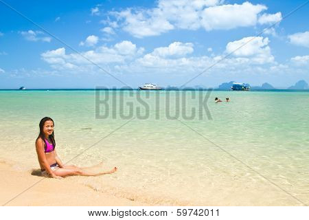 Girl Lying In The Water At The Beach Of The Koh Ngai Island Thailand