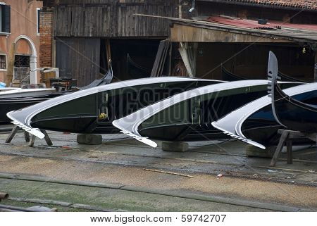 three venetian gondolas in dockyard
