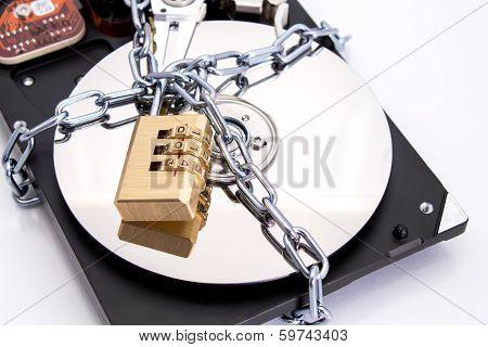 Hard drive disk and combination lock padlock.