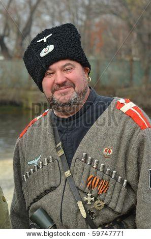 KIEV, UKRAINE -NOV 3: Member of Red Star history club wears historical uniform cossack of Corps von Panvits (German) during historical reenactment of WWII, November 3, 2013 Kiev, Ukraine