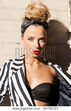 Beautiful Lady In Fashion Style Posing Against White Brick Wall