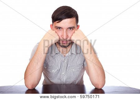 Handsome man touching his temples to calm a headache on white background
