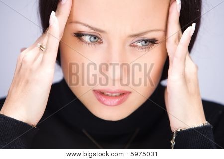Young Woman With Headache Holding Her Hands To The Head