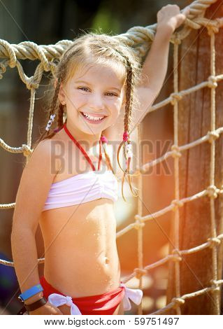 portrait of a little girl aquapark. Summer holiday.