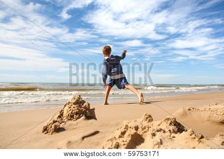 Boy throwing rocks into the lake