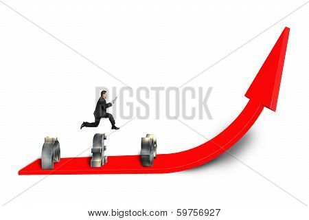 Businessman Jumping Over Money Symbols  On Growing Arrow