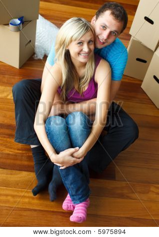 Couple Sitting On Floor. Moving House
