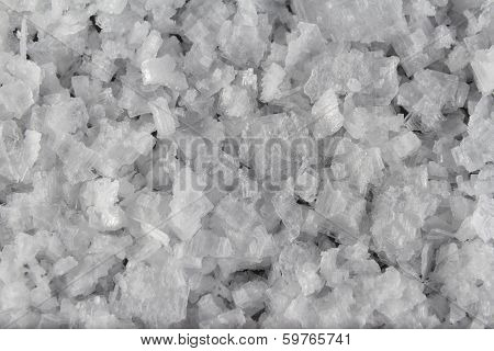 Sea Salt Flakes, Scattered To Make Background Or Texture. Macro.