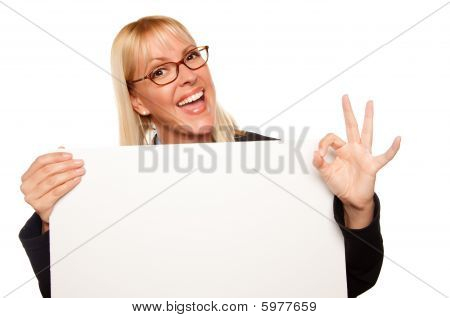 Attractive Blonde With Okay Hand Gesture Holding Blank White Sign