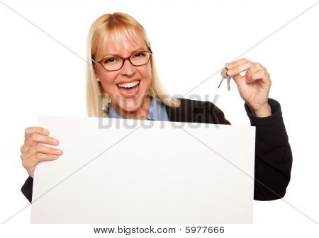 Attractive Blonde Holding Keys And Blank White Sign