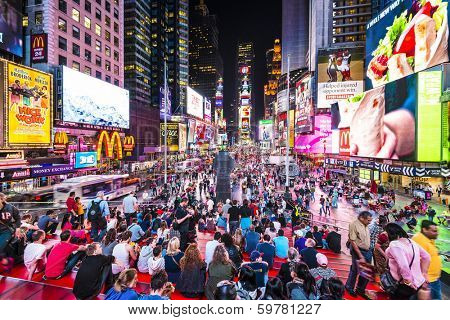 NEW YORK, NEW YORK - APRIL 9, 2013: Times Square crowds at night in Midtown Manhattan. The site is regarded as the world's most visited tourist attraction with nearly 40 million visitors annually.