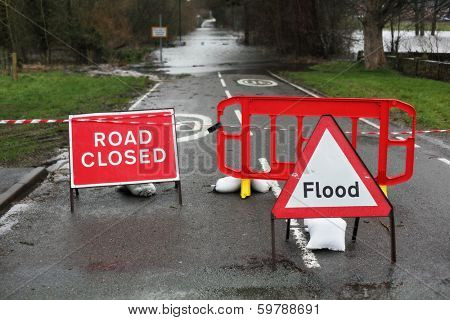 Road closed and flood sign due to heavy rain and floods