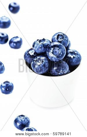 Fresh Bilberries In A Bowl  Isolated On White Background Close Up.