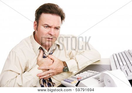 Businessman with financial problems experiencing indigestion or a heart attack. White background.