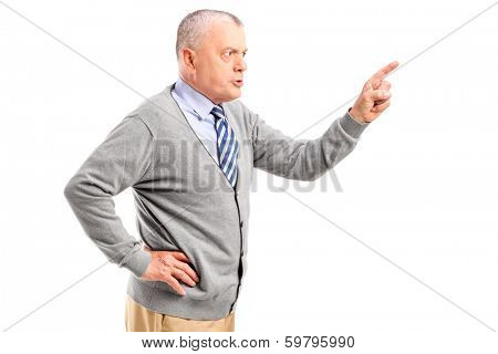 Angry mature man pointing with finger and threatening isolated on white background