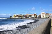image of tourist-spot  - Tourists at the pebble beach in the village La Playa on 19 January 2014 - JPG