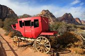 stock photo of chariot  - Old chariot in red rock canyon  - JPG