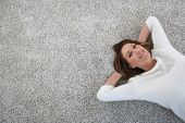 pic of 35 to 40 year olds  - Upper view of woman relaxing on carpet at home - JPG