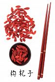 image of qi  - Wolfberry fruit chinese herbal medicine with chopsticks and mandarin script title translation - JPG